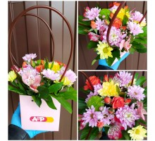 Bright floral arrangement in your purse!