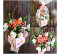 A compliment bouquet with chocolate-covered strawberries and flowers in your purse!