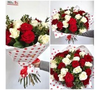 A bouquet of 25 red and white roses with boxwood!