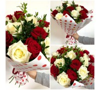 A bouquet of white and red roses, decorated with boxwood in a stylish craft package!