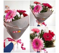 A bouquet of 5 gerberas with added greenery!
