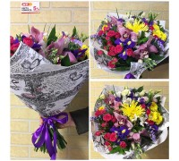 Unusual, bright spring bouquet in a stylish package!