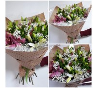 Delicate bouquet of lilies and gypsophila in a stylish package!