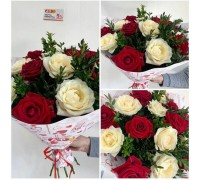 A bouquet of white and red roses with boxwood!