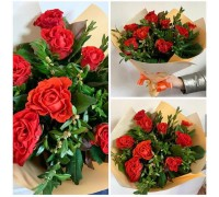 A charming bouquet of 9 Pioneer roses and boxwood.