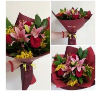 Bouquet of lilies, roses and mimosa in a stylish package!