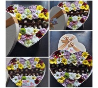 Composition of chrysanthemum and chocolate letters in a box!