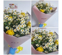 A bouquet of bright yellow spring tulips with summer playful daisies!