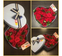 Red roses in a hat box in the shape of a heart!