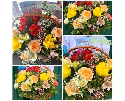 Flower arrangement in a wicker basket!
