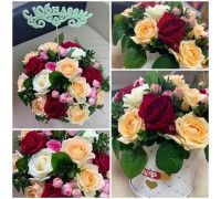 Arrangement of roses in a hat box!
